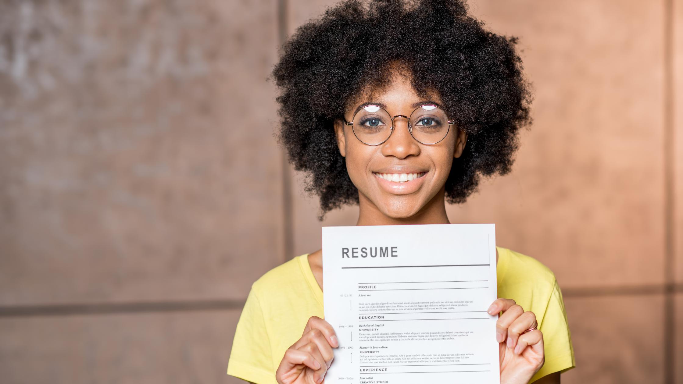 Job candidate holding standard resume
